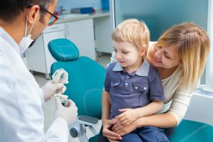What Is Pediatric Dentistry child mum at dentist