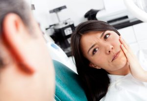 What Is Root Canal Treatment woman jaw pain